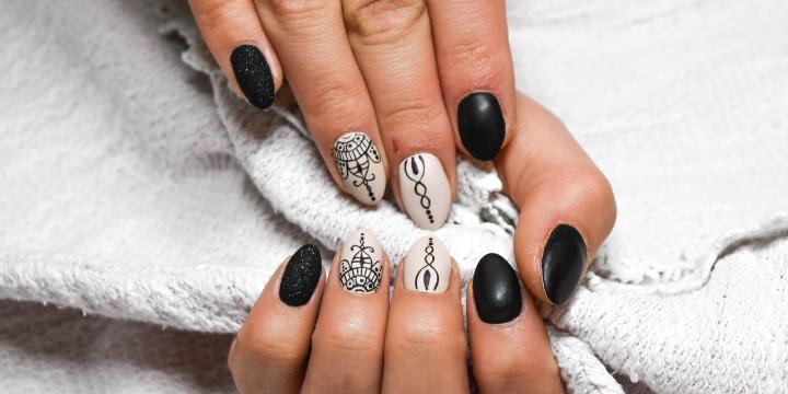 50% OFF Manicure & Pedicure offer image